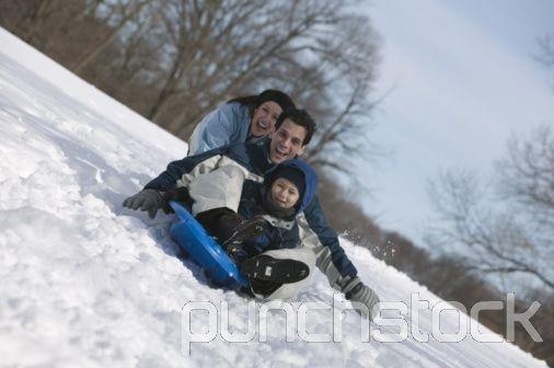 Family sledding together.