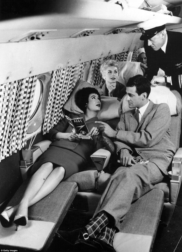 Passengers relaxing on the sleeper seats in the new Comet 4 during a demonstration flight at Hatfield in 1958