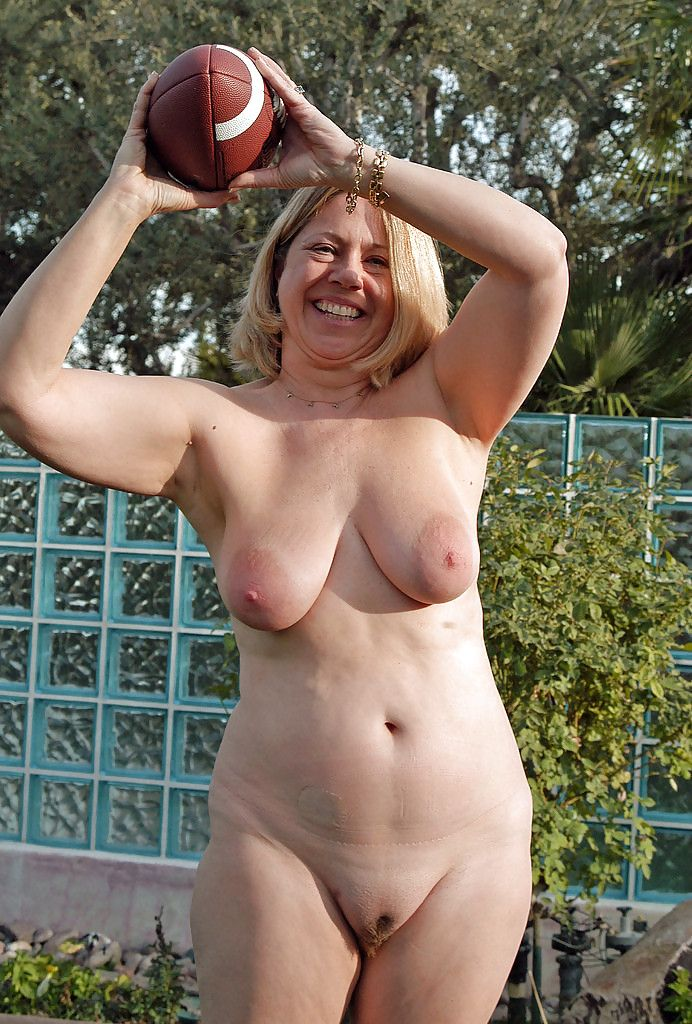 Naked mature outdoors