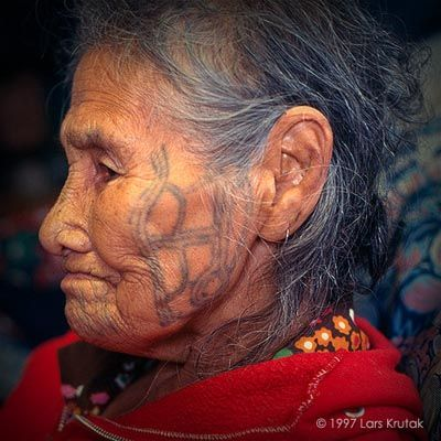 "Qayaghhaq, one of the last completely tattooed St. Lawrence Island Yupiget women, said of tattooing: ""We did it to be beautiful, so that we would not look like men. We wanted precious pictures for the afterlife."" She also wears a set of three fertility tattoos on her outer cheek and qilak or ""heavens"" tattoos near the ear."