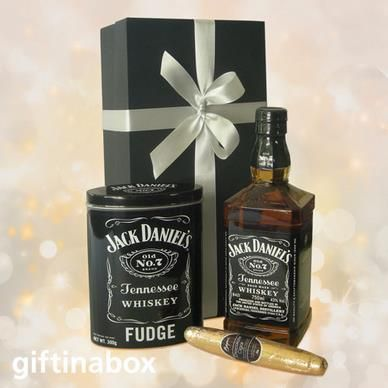 JACK DANIEL'S SPECIAL A great combination of whiskey, fudge and chocolate cigar to make that special man smile. Makes a wonderful congratulations gift!   Jack Daniels Tennessee whiskey Jack Daniels fudge in keepsake tin Belgian chocolate cigar