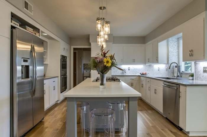 White kitchen cabinets. Painted in Benjamin Moore Advance ...
