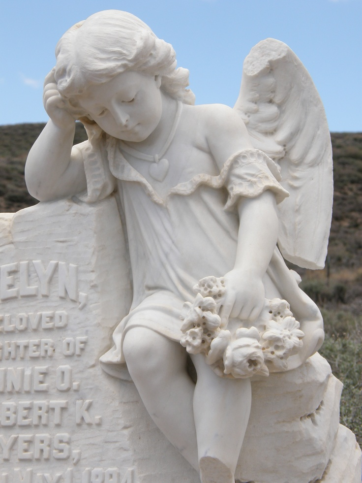 Old Mining Town in California. Cemetery angel.