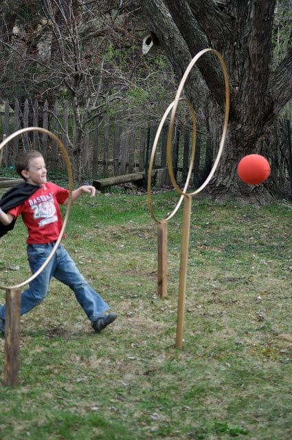 All you have to do is spray paint hula hoops and nail them into wood. Learn more here.