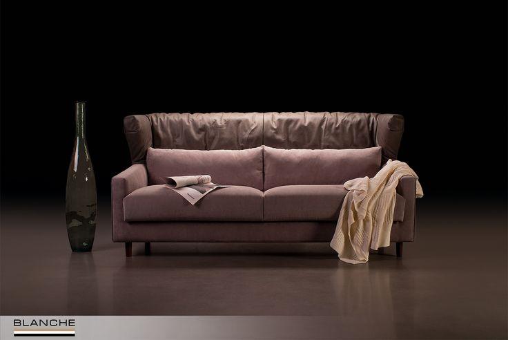 """Серийный диван MILTON.  Комбинация натуральной итальянской кожи и текстиля из коллекции Manchester.  Выразительный дизайн с модными """"крыльями"""" делает модель MILTON превосходным решением для создания стильного современного интерьера. Ультра мягкие сидения, высокая спинка и дополнительные спиновые подушки обеспечивают максимально комфортный отдых."""