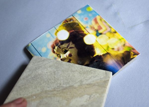 DIY Picture tiles -- You will never buy a photo frame again. (Well, unless you really like photo frames, too.) Another great use for Mod Podge.