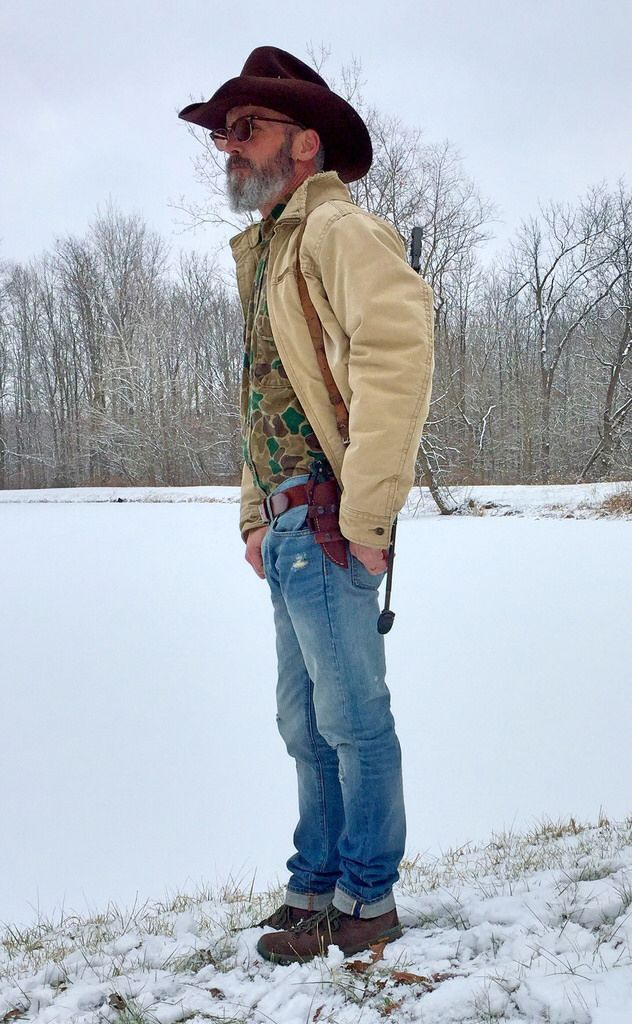 Eddy Bros vintage cowboy hat, RayBan glasses, Woolrich vintage flannel shirt, Abercrombie & Fitch canvas work coat, Japanese selvage denim, Danner hiking boots, Damascus steel hunting knife, AMD65.