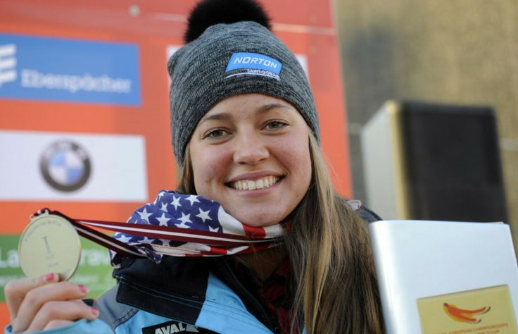 Placed first United States' Kate Hansen displays her medal during the award ceremony of the women's race at the Luge World Cup event  in Sigulda, Latvia, Saturday, Jan. 25, 2014.  Uses size