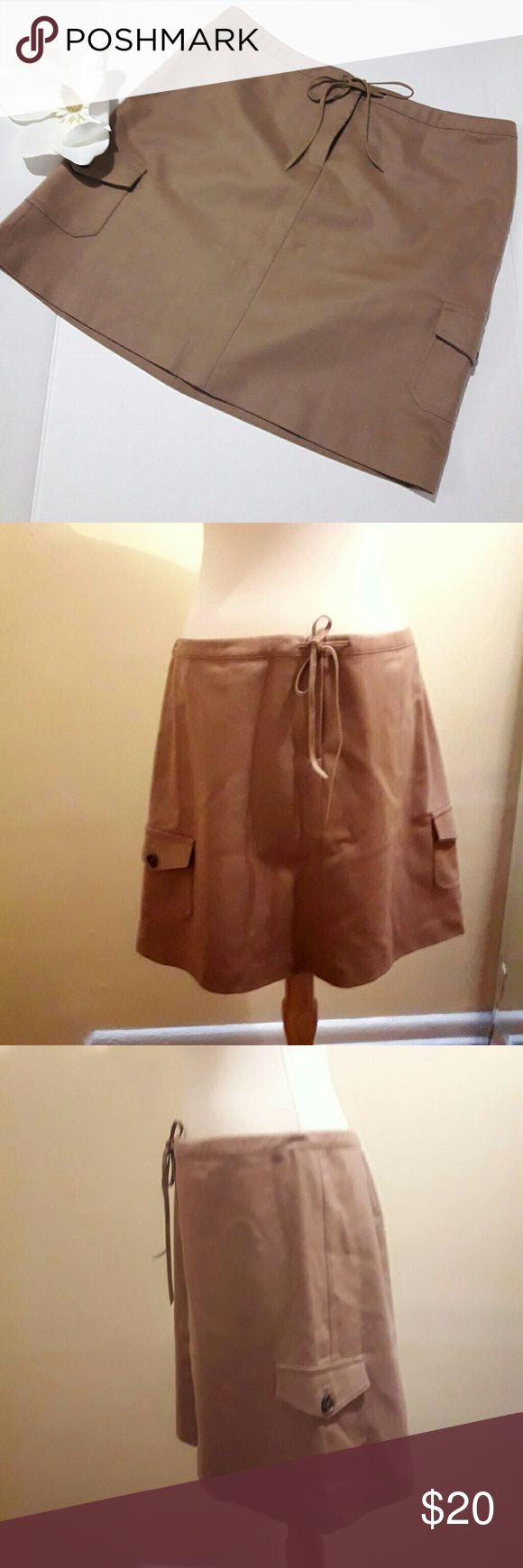 "J.crew Factory Store Tan skirt size 10 ♡Length: ~17""  ♡Waist:~16.5""  ♡Dry clean only  ♡Pre-owned; great condition, no stain, tear, or rips.  ♡Due to studio lighting, product be may lighter or darker in pictures. ♡ Bundle 2 or more items in my closet to save 10% and pay only ONE shipping fee!!! #11 J. Crew Factory Skirts Mini"