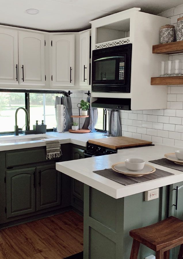 This Remodeled Rv Has The Coziest Fireplace Tiny House Camper Kitchen Remodel Green Kitchen Cabinets