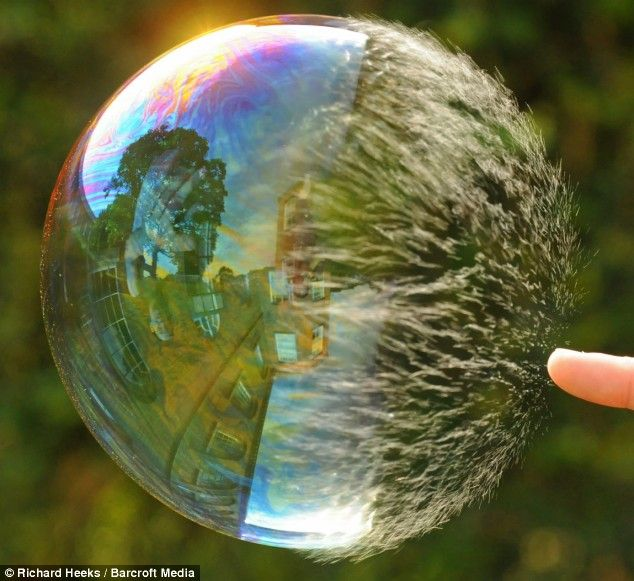 Super-slow-motion pictures show soap bubble bursting in stunning ...