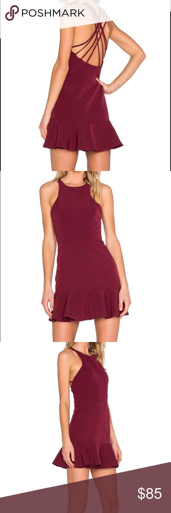 "NBD • Bound For Glory Dress NBD Bound For Glory Dress in Oxblood NWT Retail $170  - Crew neck - Sleeveless - Hidden side zip closure - Multi-strap crisscross back - Flounced hem - Solid construction - Lined - Approx. 34.5"" length NBD Dresses Mini"