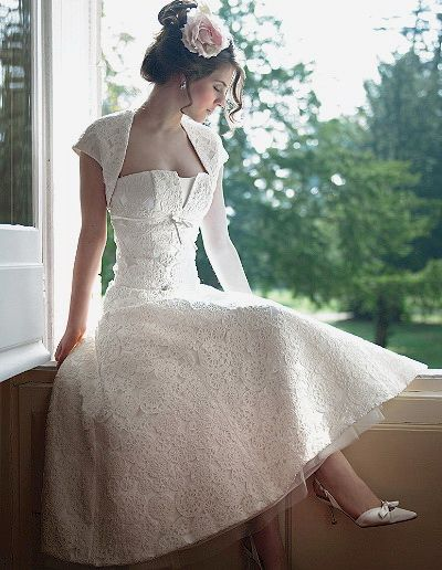 1950s wedding dress. While I don't think I would wear it on my wedding day, I think it's really cute and simple!