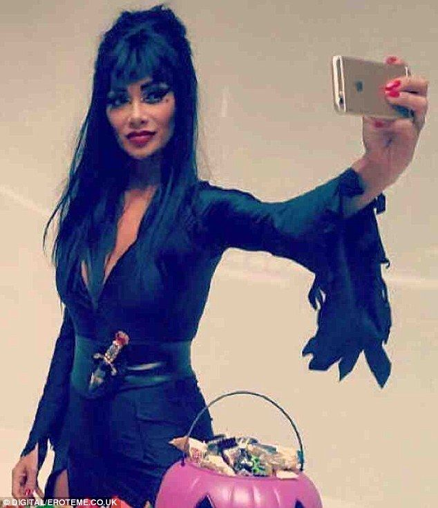 nicole sherzinger dazzles as elvira in sexy halloween costume nicole scherzinger sexy halloween costumes and halloween costumes - Stunning Halloween Costumes