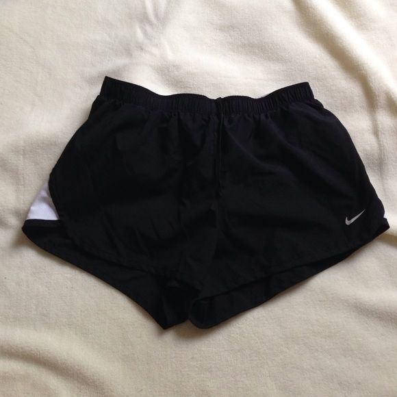"Black Nike shorts Womens size small. Black and white colors. New condition. Built in shorts. Inseam is 2"". No trades. Please use offer button. Nike Shorts"