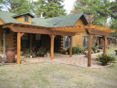 Rustic Pergola Looks Great Attached To Log Home Rustic