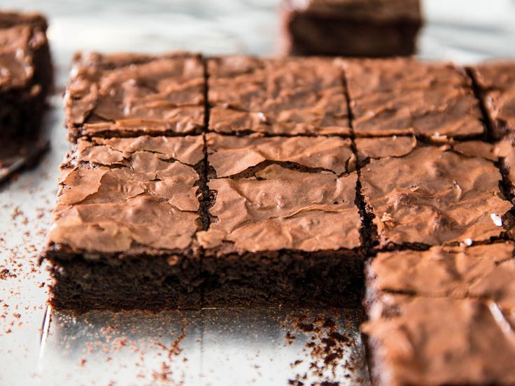 Make Better Brownies With Brown Butter (and Double the Chocolate) | It's a hefty square of chocolate to be sure, but fudgy rather than gooey, with just a little bit of chew, and a shimmery, paper-thin crust on top.