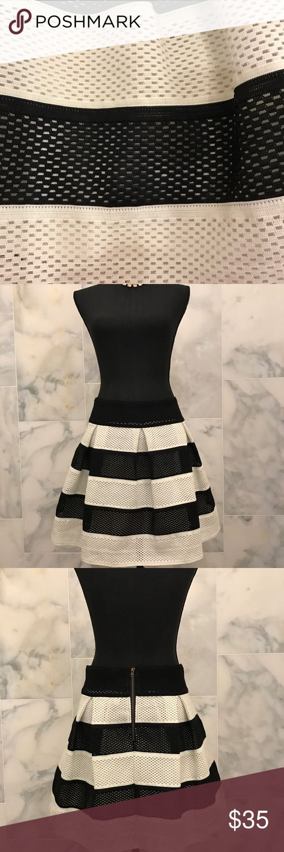 Umgee black & cream skirt Super cute Umgee black/cream wide stripped skirt. Cut out print fabric see pic. Very forgiving and flattering. New w/o tags. Umgee Skirts