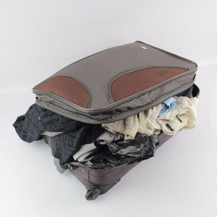A large suitcase containing a quantity of various clothing - https://lostparcels.com/parcel-company-3/uncategorized/a-large-suitcase-containing-a-quantity-of-various-clothing/