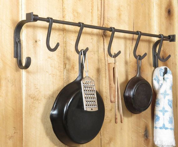For those of us who prefer the cooking properties of cast iron, it can be difficult to find a suitable pot rack. The design of my Craftsman Pot