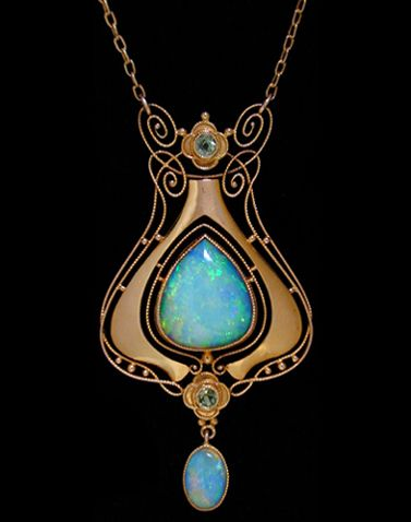 MURRLE BENNETT & Co. (1896-1914) gold pendant set with a large central opal surrounded by wirework motifs set two peridots and with an opal drop