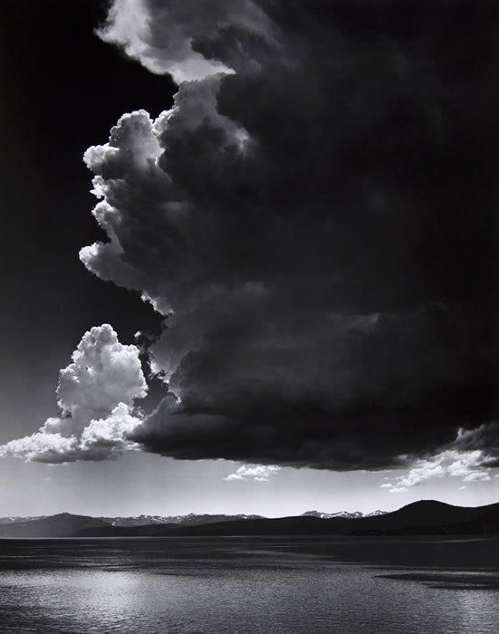 "Ansel Adams  ""Thundercloud"" 1936  Ansel Easton Adams was an American photographer and environmentalist. His black-and-white landscape photographs of the American West, especially Yosemite National Park, have been widely reproduced on calendars, posters, and in books. Wikipedia"