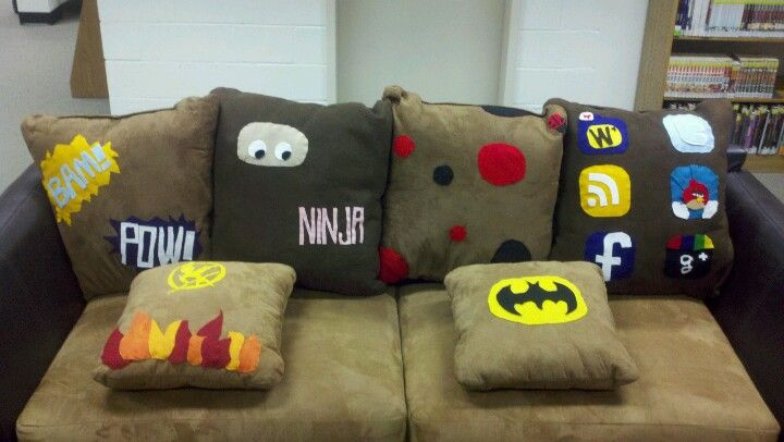 Teen Spot pillows. Cut designs out of felt and stitch them to pillows. Cute idea to help teens decorate their teen library space.