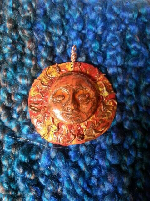 Check out this item in my Etsy shop https://www.etsy.com/uk/listing/289118759/clay-pagan-sun-god-pendant