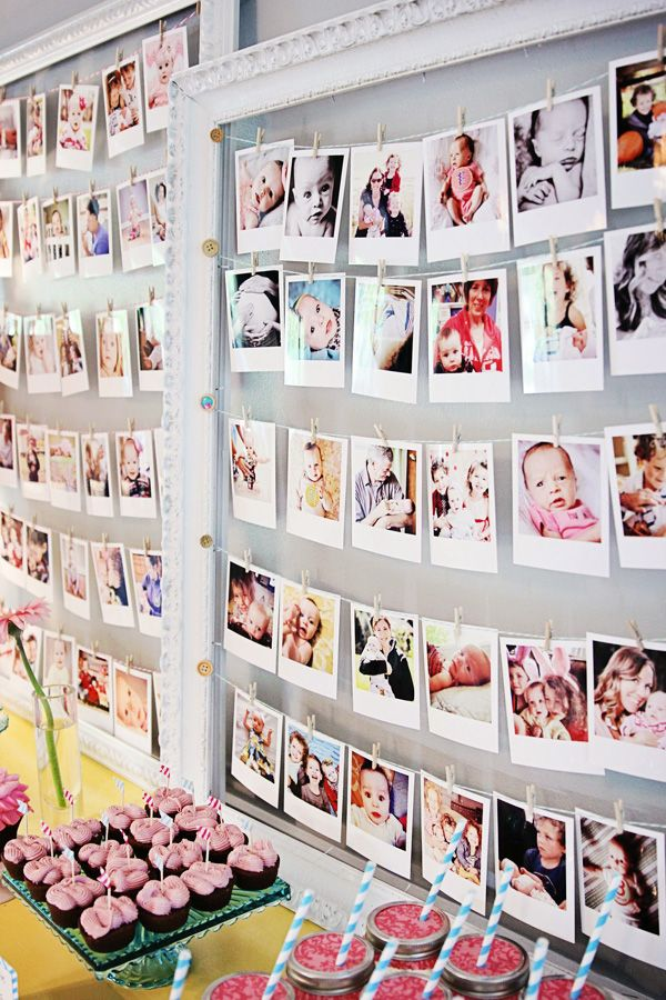 "Giant empty frames with strings of ""polaroids"""