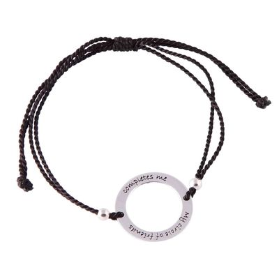 """Sterling silver circle bracelet on adjustable black silk cord. """"My circle of friends completes me"""""""