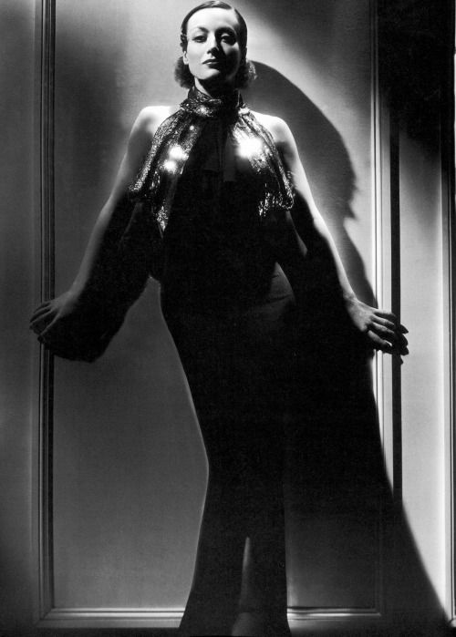 Joan Crawford in a publicity still for Sadie McKee (1934) wearing a gown by Adrian photographed by George Hurrell