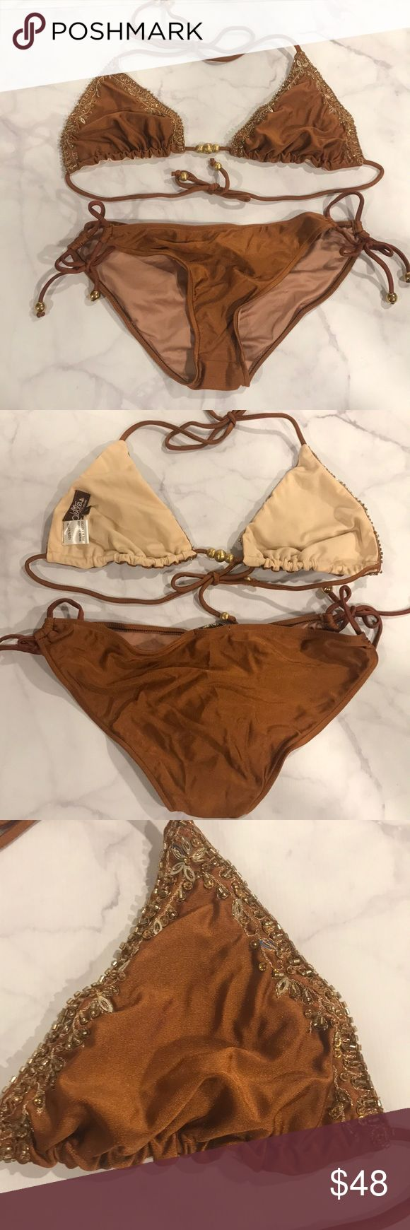 NWOT Never Worn Lotta Stensson Gold Beaded Bikini NEW WITHOUT TAGS, Never Worn Lotta Stensson Gold Beaded Bikini -  Goldish Brown Triangle bikini with gorgeous gold beading on the top. Bottom ties at both sides with gold beads on the ends of the ties. Still has hygienic lining in it because it's never been worn.  Size L Lotta Stensson Swim Bikinis