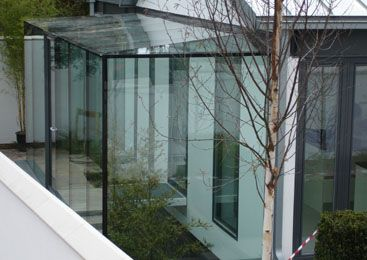 Lean to frameless glass conservatory