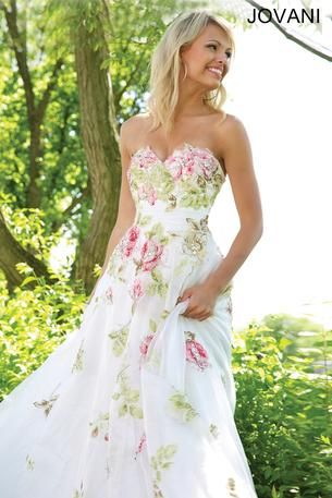 Beautiful A-line floral dress features a sweetheart neckline and crystal embellishments