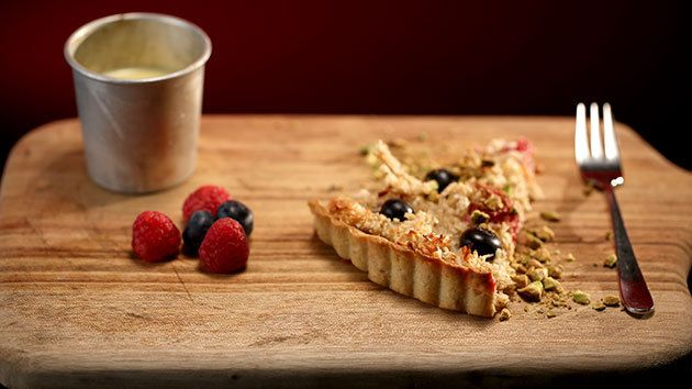 Berry, spelt and macaroon tart with creme anglaise .. Healthy dessert