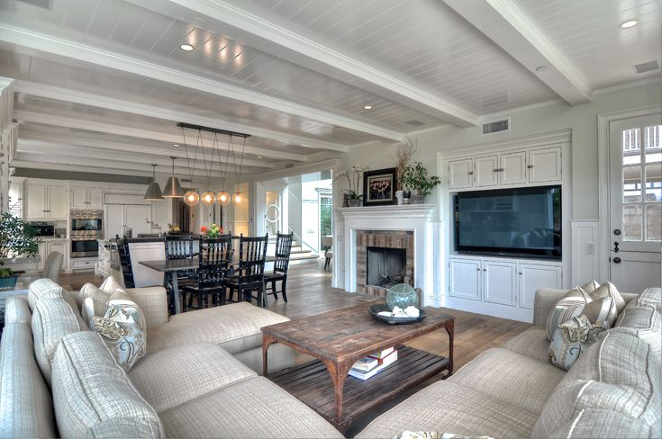 Family Room: New England Architecture, New England style, Colonial, Cape Cod, traditional, classic, beach   architecture, beach style, beach organic,  painted post & beam ceilings, natural wood flooring, recessed can and pendants light chandelier, large bi-folding doors, sliding doors, wood windows, outside dutch door, classic wood wainscot, traditional style door & window trim/molding, traditional brick fireplace, painted fireplace mantel. builtin desk entertainment center & cabinets,
