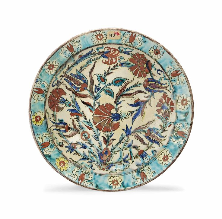 A KUTAHYA POTTERY DISH - OTTOMAN TURKEY, 19TH CENTURY.