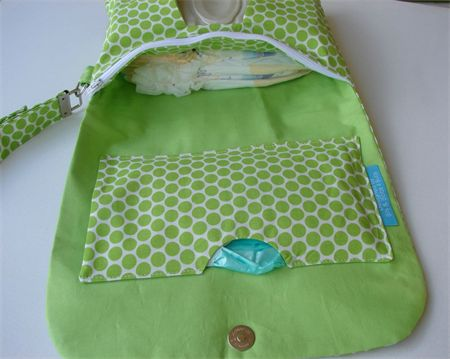 Clutch nappy wallet with hand sanitiser holder