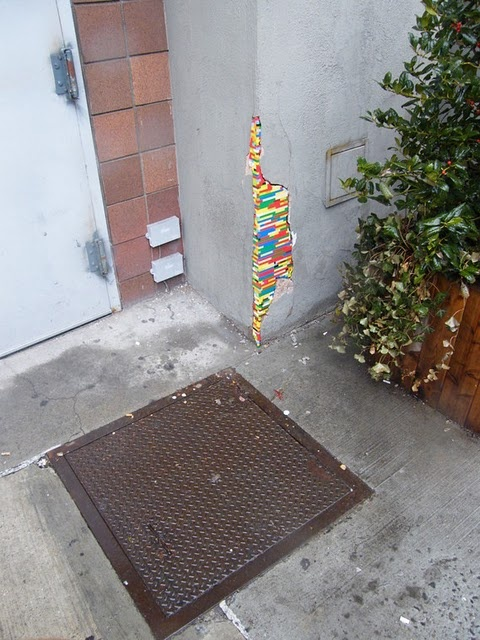 This person goes around filling in building cracks with Legos.