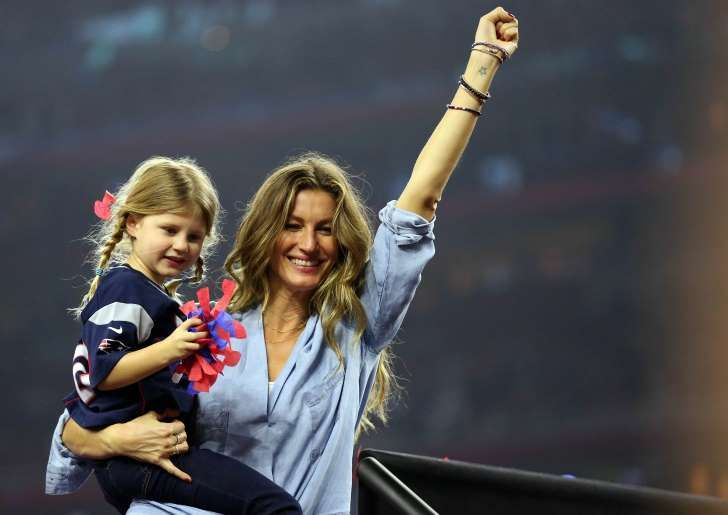 Gisele Bundchen and daughter Vivian Brady celebrate after the New England Patriots beat the Atlanta Falcons during Super Bowl LI at NRG Stadium.