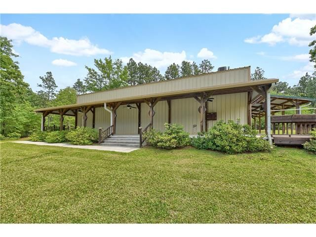 Truly one of a kind home on 4.6 acres w/ detached 1300sqft Barn w/ loft! This warehouse has been transformed into a 1233sqft 2-level home including living room/kitchen/4bd/1.5bth/deck & usable 855sqft workshop perfect for your boat or RV! Home/warehouse includes 11 faucets, 2 trailer hook-ups, (1) 220 outlet, 2 expansive covered porches all built on 6inch thick concrete slab. Optional diesel tank w/ commercial grade generator. Barn is 9 yrs old w/ 2 pin & stable stalls & loft. Completely…