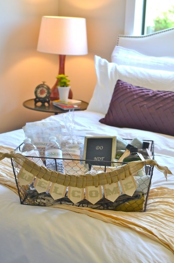 Guest room basket. Such a great thing to do! Have towels, water, a few toiletries, healthy snacks,  light reading. Great idea for guests!