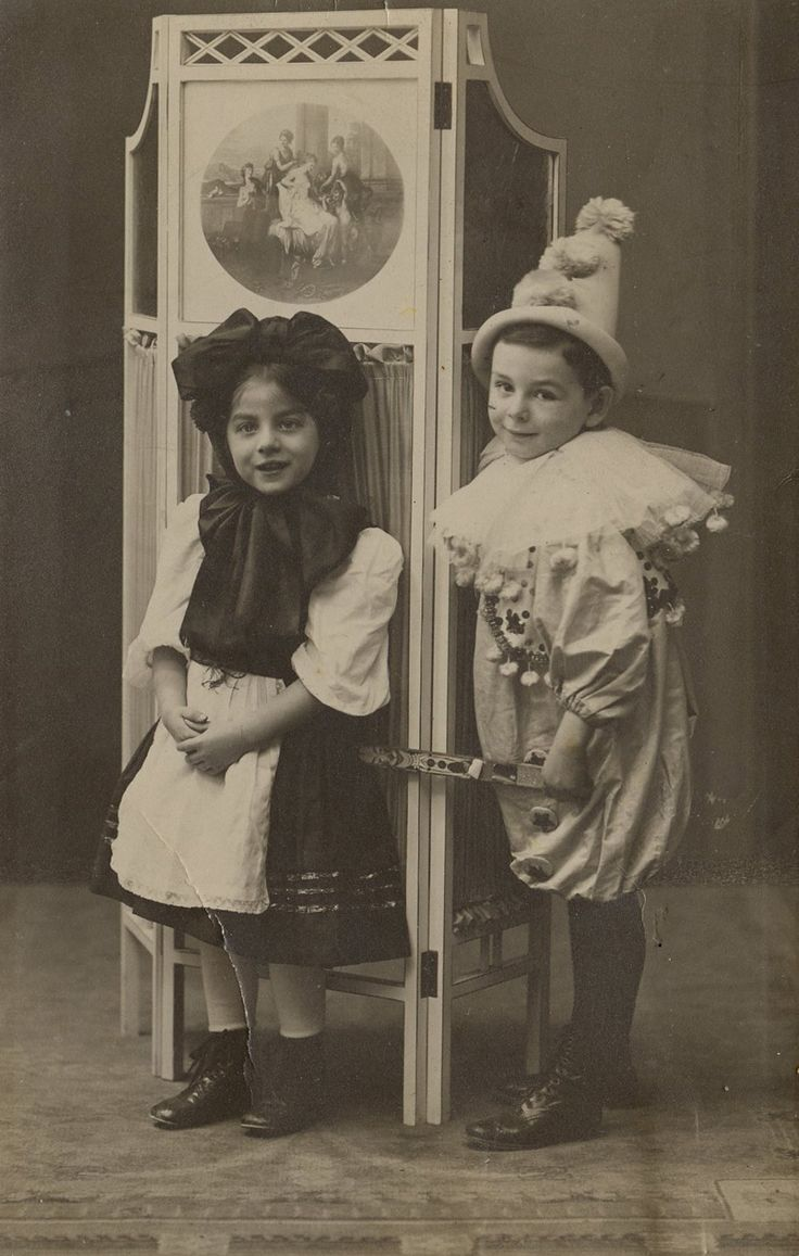 German photo of a brother and sister dressed in Carnival costumes. Circa 1920s.