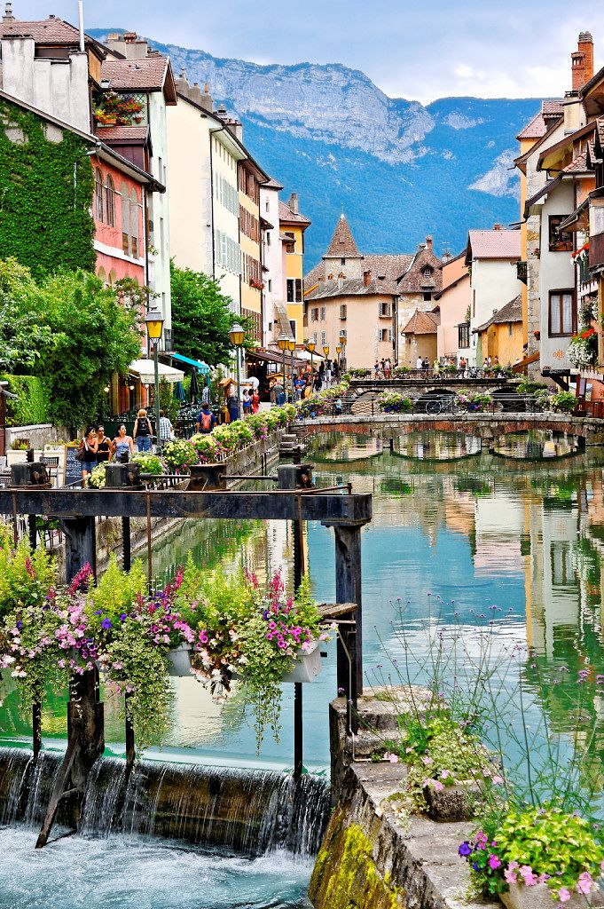 Annecy, France.I can't look past Annecy when it comes to rounding up the most gorgeous, charming towns in France. It is an alpine town in southeastern France, where the River Thiou meets Lac d'Annecy. It's everything you'd find in a fairy tale. Cobbled streets, winding canals and pastel-coloured houses. Pretty as a postcard.
