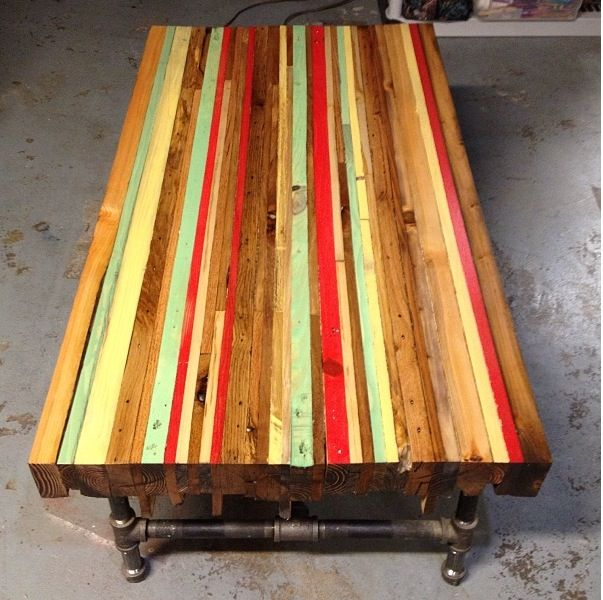 "Wooden table made of reclaimed pallets finished with colored wood stains on top and a dark walnut around the sides and end grain. Legs are 3/5th"" black steel pipe."