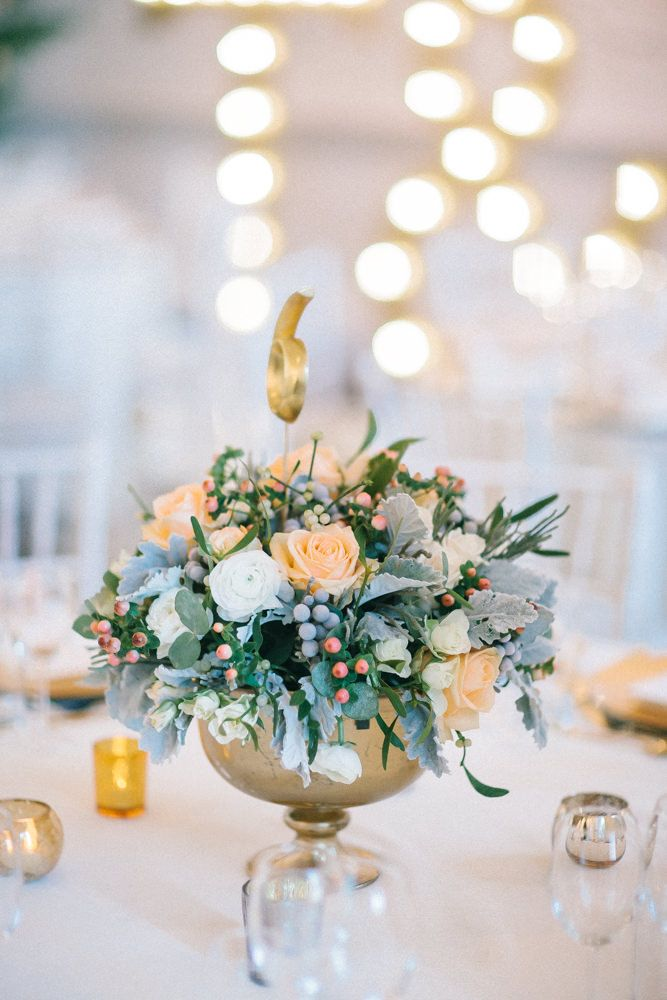 Peach & White rose Winter Centrepieces - Image by Chris Barber - Justin Alexander Wedding Dress For A Winter Wedding At Compton Verney Art Gallery With Groom In Reiss And Bridesmaids In Embellished Dresses From Miss Selfridge With Images By Chris Barber And Videography By Simon Clarke Films