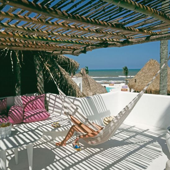 Hammock on a private terrace at Azucar Hotel in Mexico. Architects Elias Adam and Jose Robredo, interior designer Carlos Couturier. Foto Design Hotels