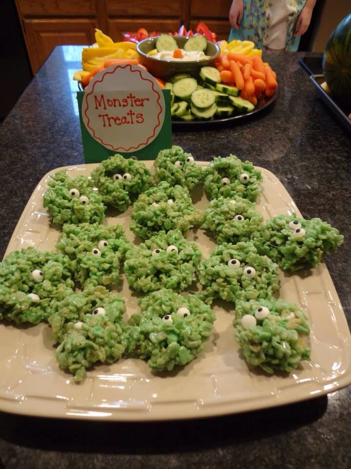 Monster party food idea. Green rice crispies with eyes for monster treats.