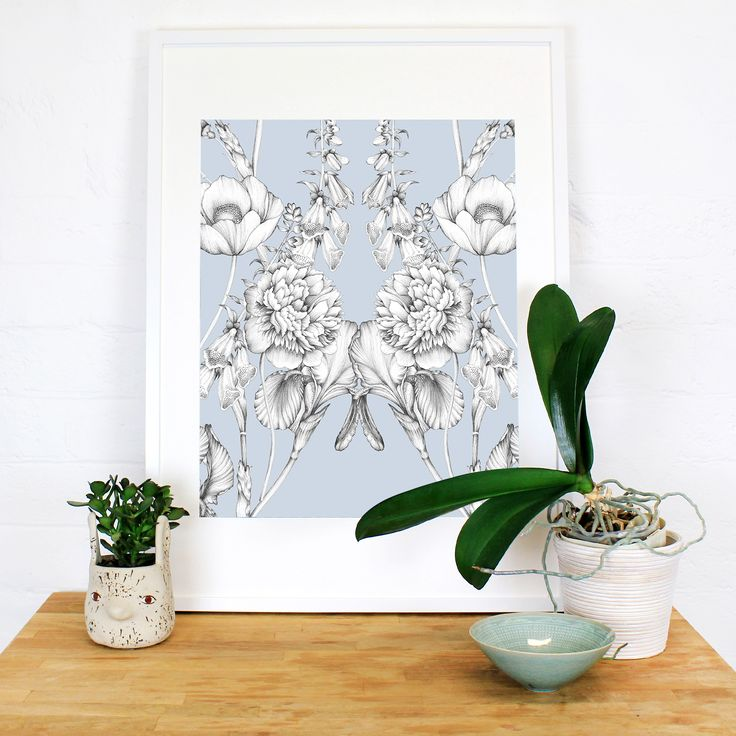 A mirrored composition of garden florals on a soft, dusty blue ground creates a wonderfully traditional yet modern feeling for this artwork. Hand illustrated iris's, poppies, peonies and foxgloves flow aound the canvas. This artwork took around 80 hours to illustrate.