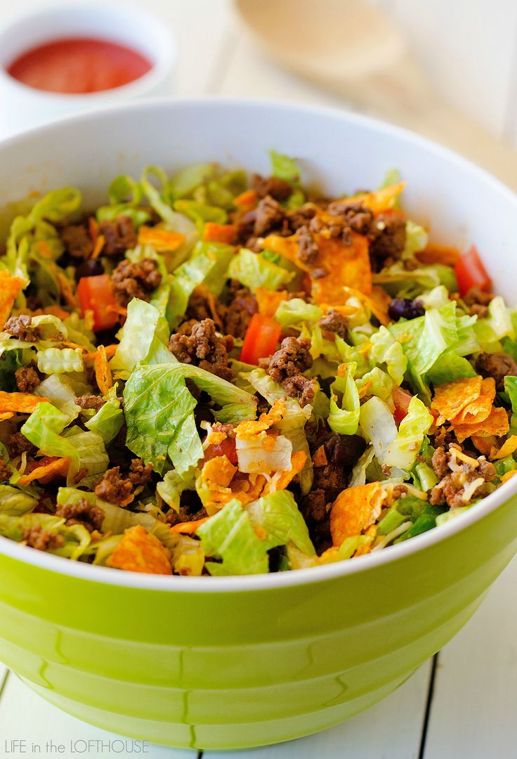My family and I love this salad. It is packed with all kinds of deliciousness. Seasoned ground beef, black beans, cheese, lettuce and don't forget the Nacho cheese Doritos.  They make the salad!    This Doritos Taco Salad comes together in just about 20 minutes tops! Salads like this are my go-to for easy... Read More »